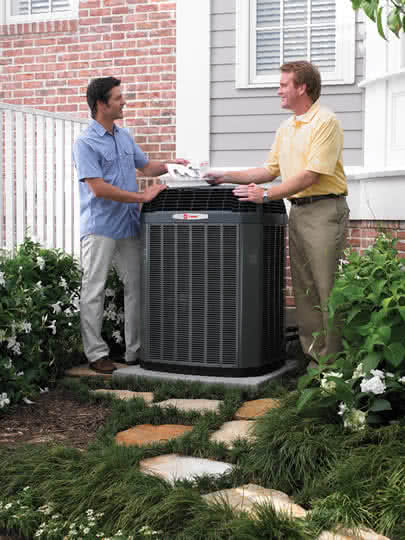 trane dealer handing brochure to customer
